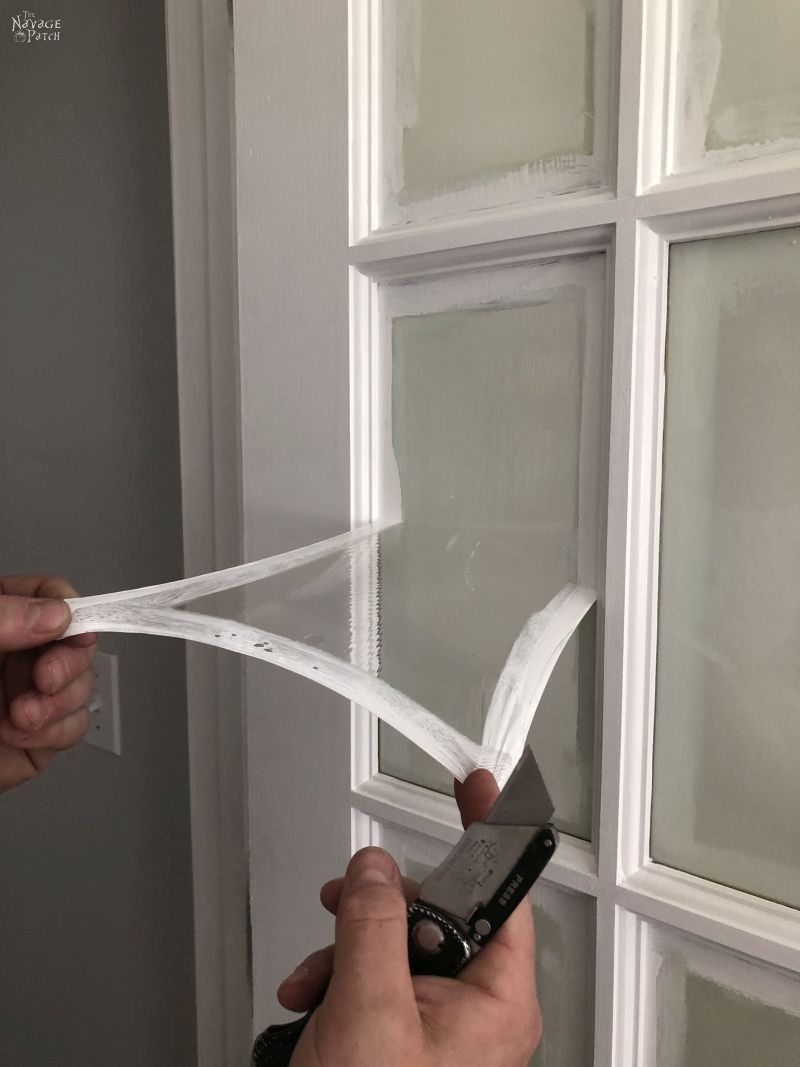 peeling masking liquid from a french door