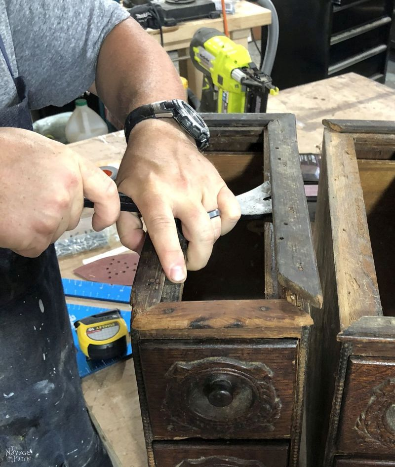 working on an antique sewing machine drawer upcycle