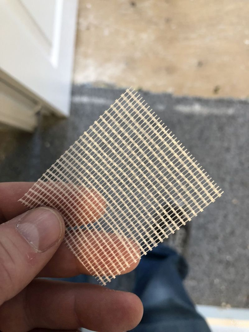 square piece of drywall tape