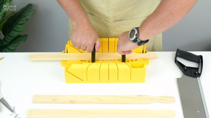 locking wood in a miter box