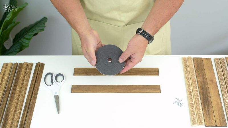 holding a roll of magnetic tape