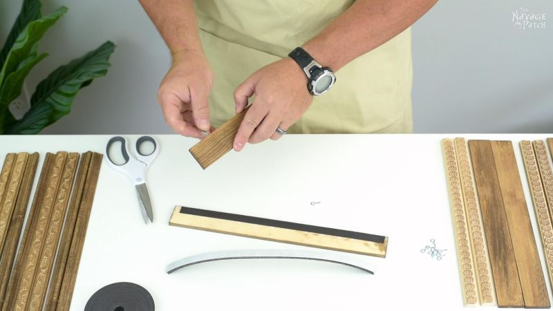 adding eye bolts to a magnetic poster hanger