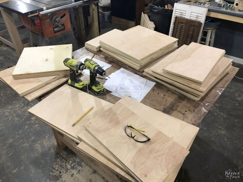cut plywood on a table for a diy storage tower