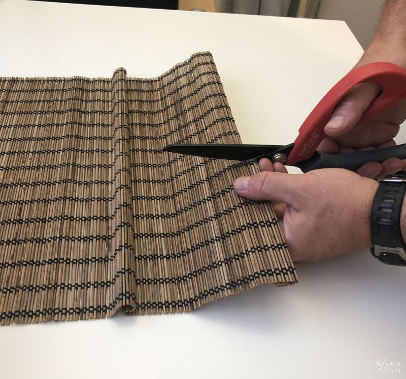 cutting a bamboo placemat for a coffee can repurpose