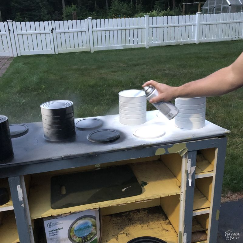 spray painting coffee cans