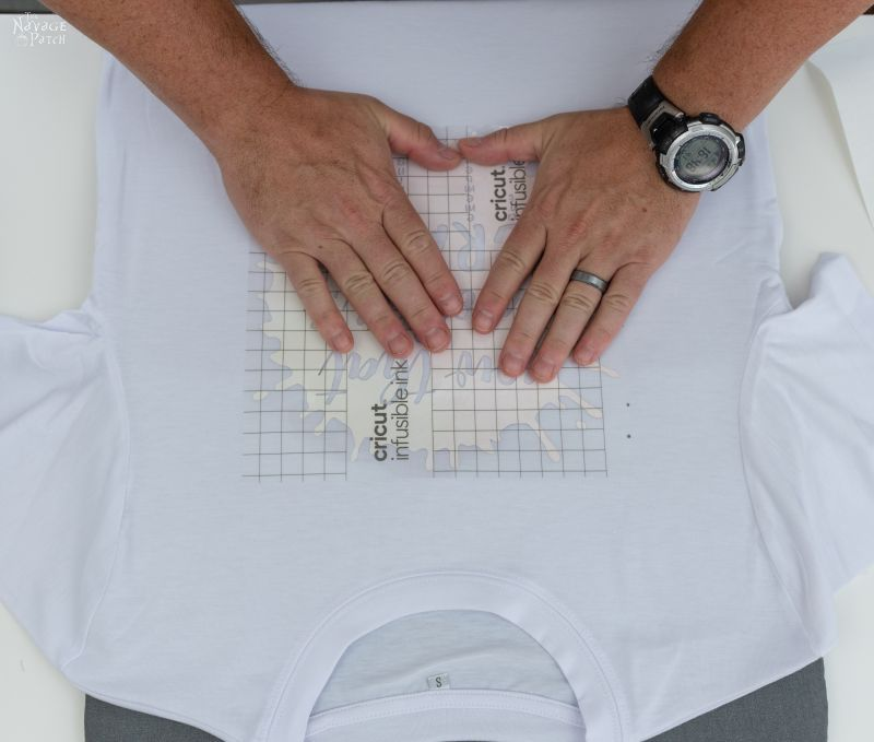 positioning an infusible ink transfer sheet on a t shirt