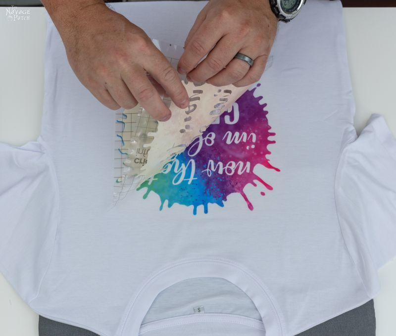 peeling the transfer sheet from an infusible ink heat transfer