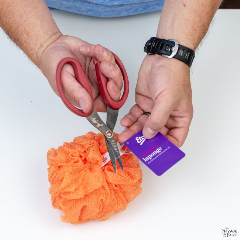 cutting the tag off a shower pouf