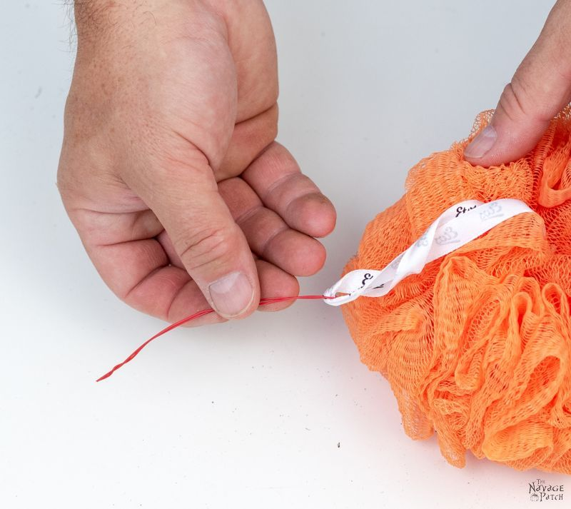 making shower pouf pumpkins