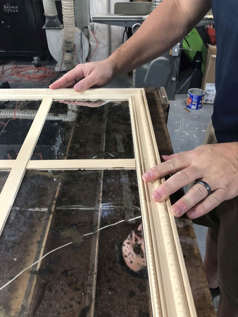fitting moulding around a diy antiqued panel mirror
