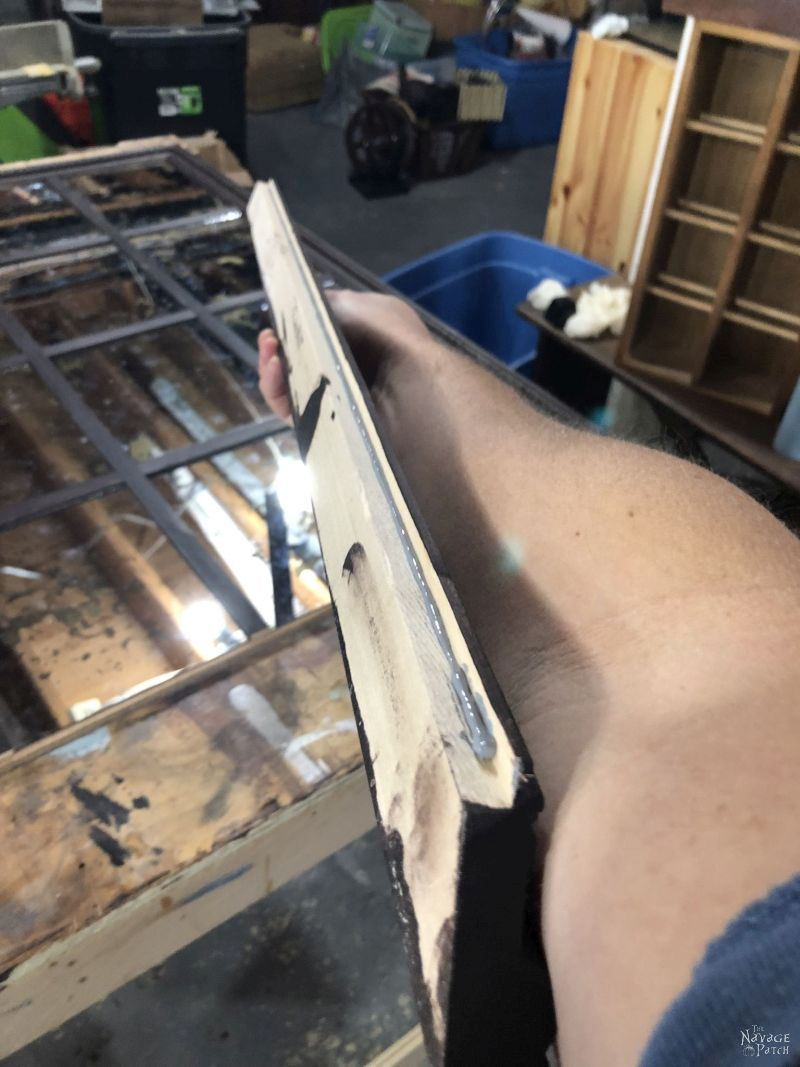 construction adhesive on piece of frame moulding
