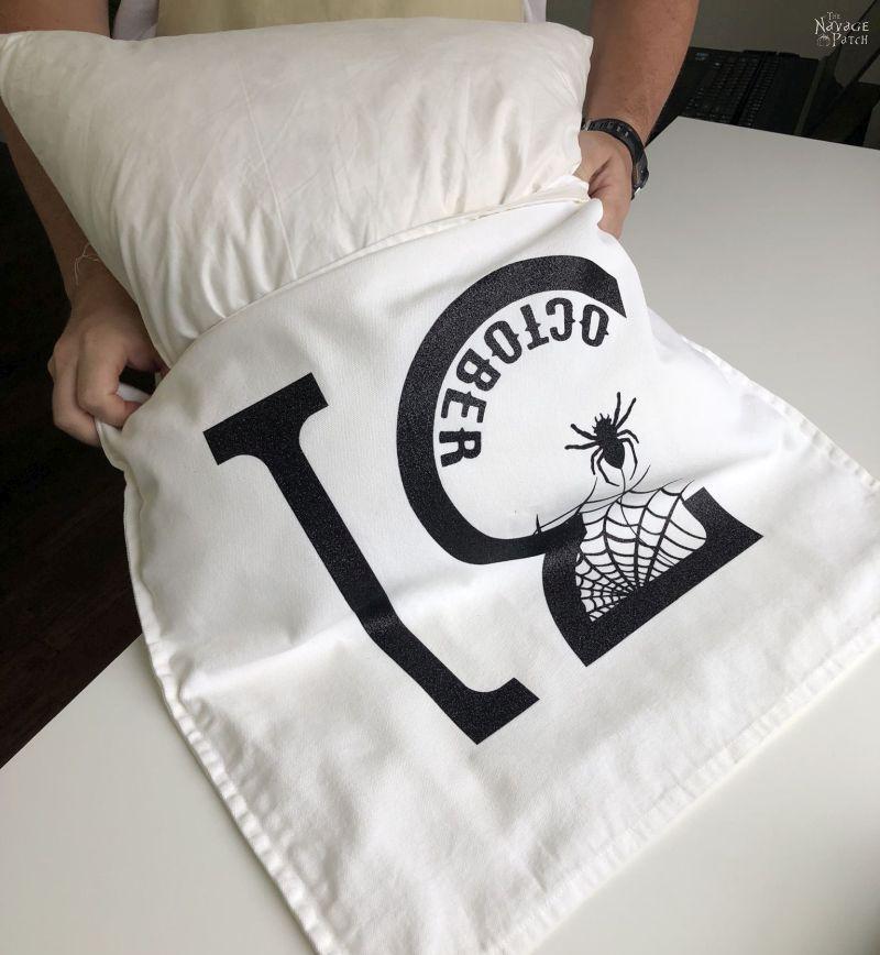 stuffing an insert into a diy halloween pillow cover