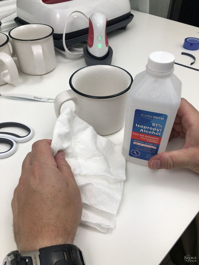 cleaning a mug with rubbing alcohol