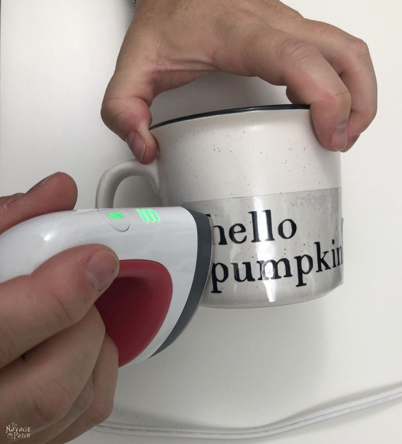 using a cricut easypress mini to transfer a design onto a mug