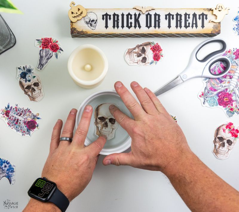 making a DIY halloween candle with waterslide decals