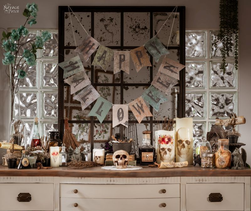 halloween garland hanging over an antique mirror