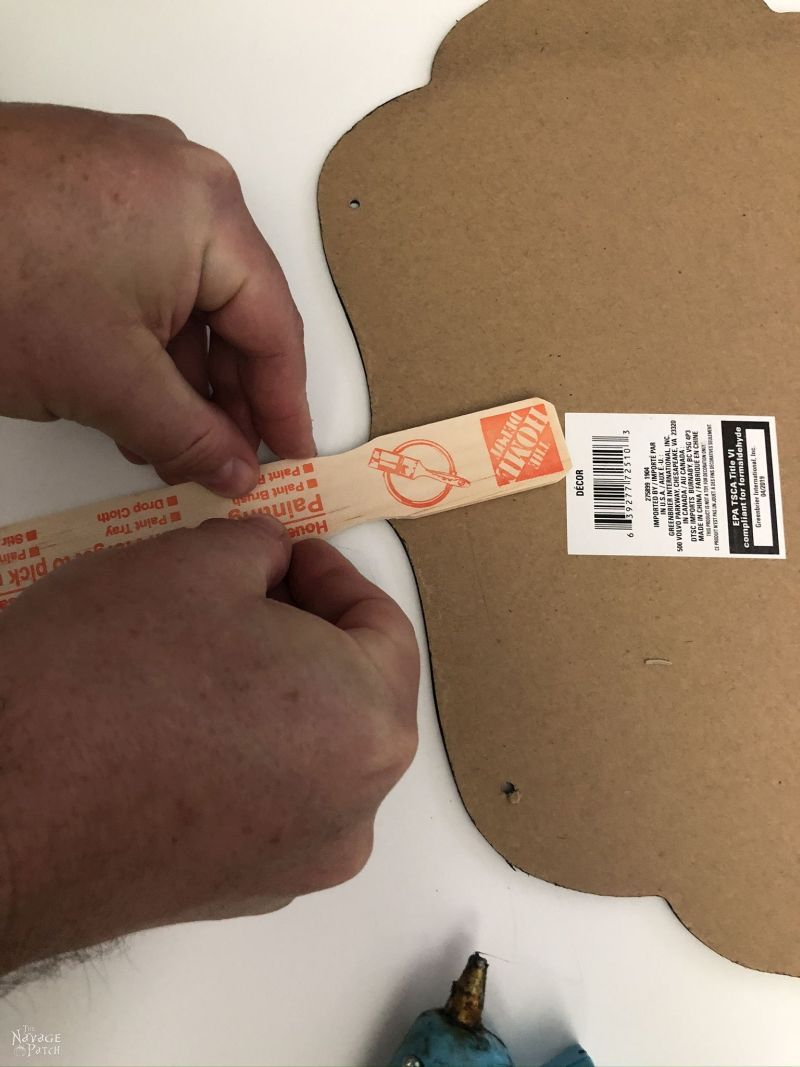 adding a stick to a halloween sign