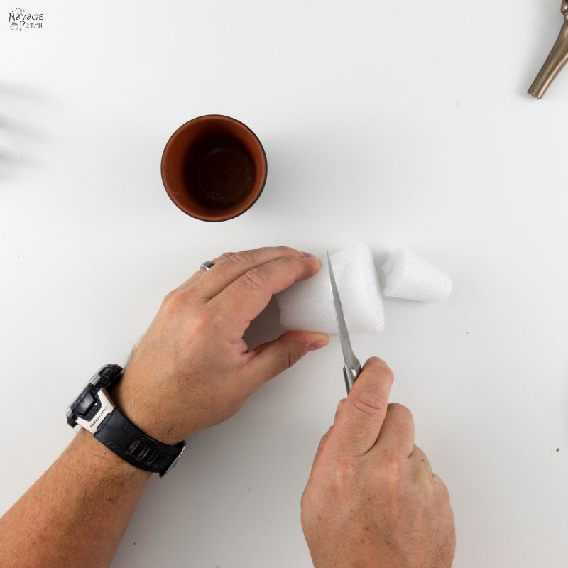 cutting a styrofoam cone with a knife