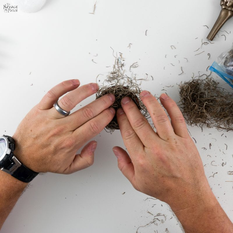 adding spanish moss to diy skeleton place card holders