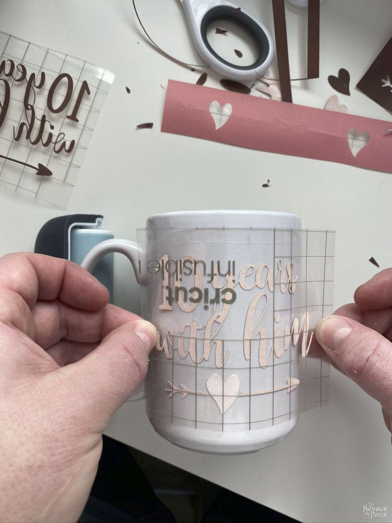 putting infusible ink transfer sheet design on a mug