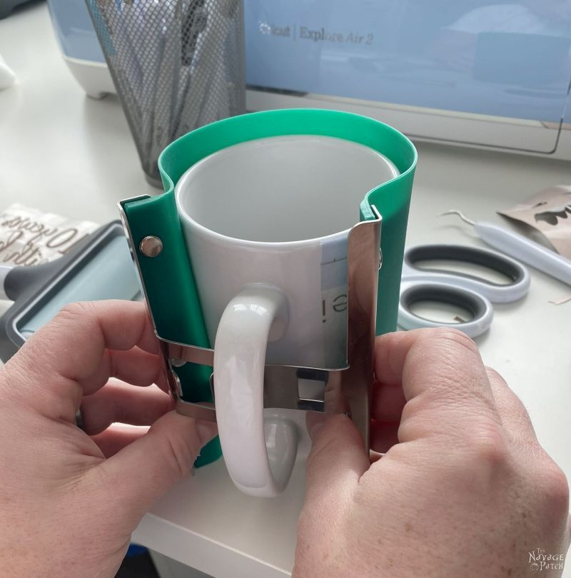 wrapping a silicone sublimation wrap around a mug
