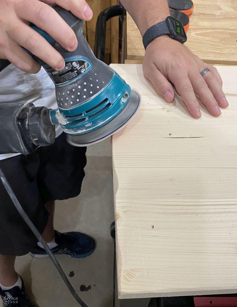 sanding a board