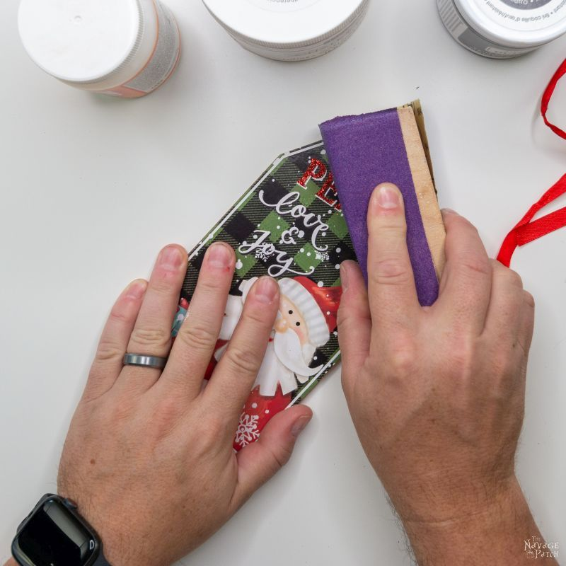 sanding the gift tag