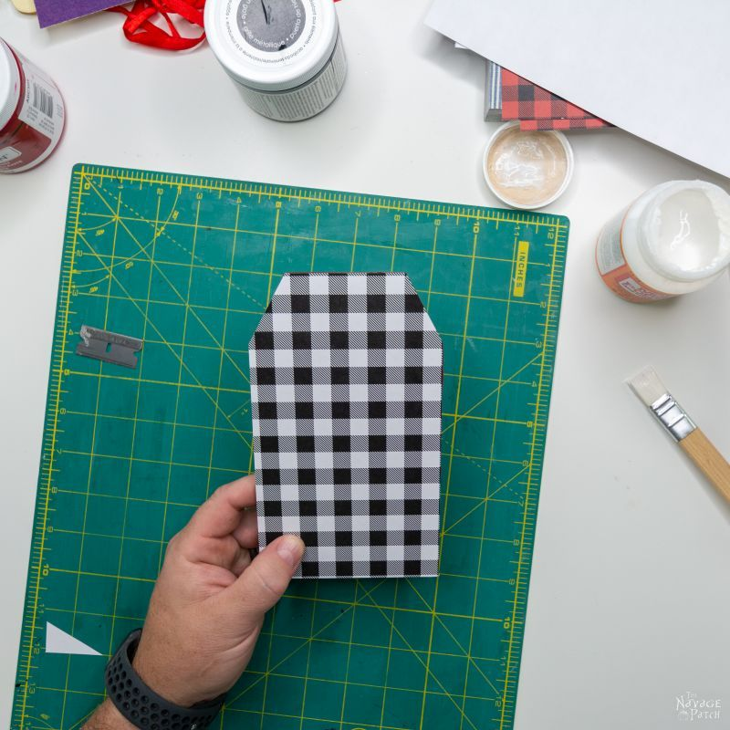 putting scrapbook paper on gift tags