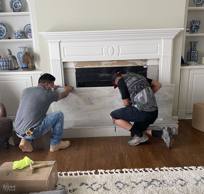 adding a marble hearth to a fireplace makeover