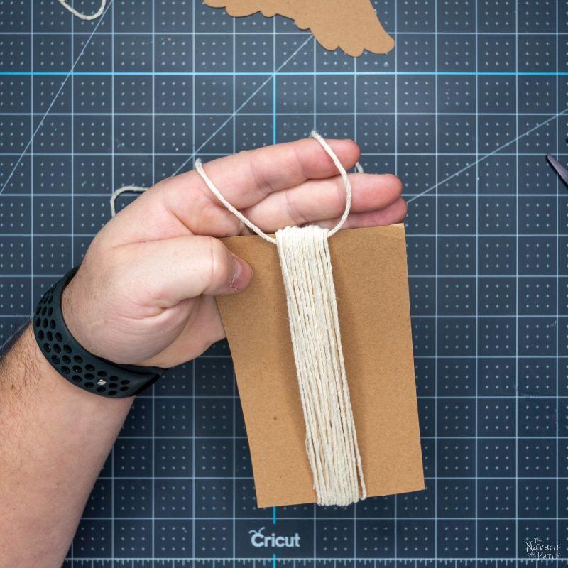 tying string to make a tassel