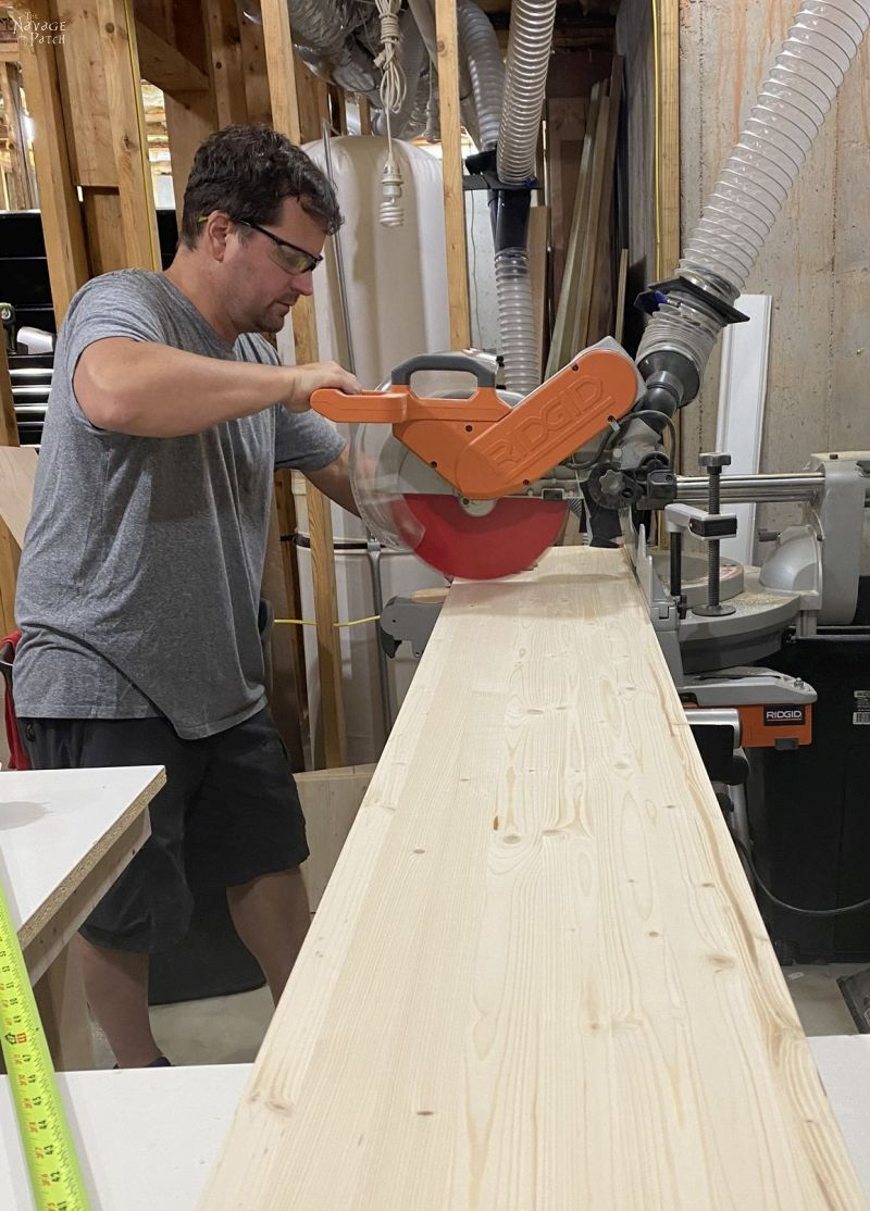 cutting a board with a miter saw