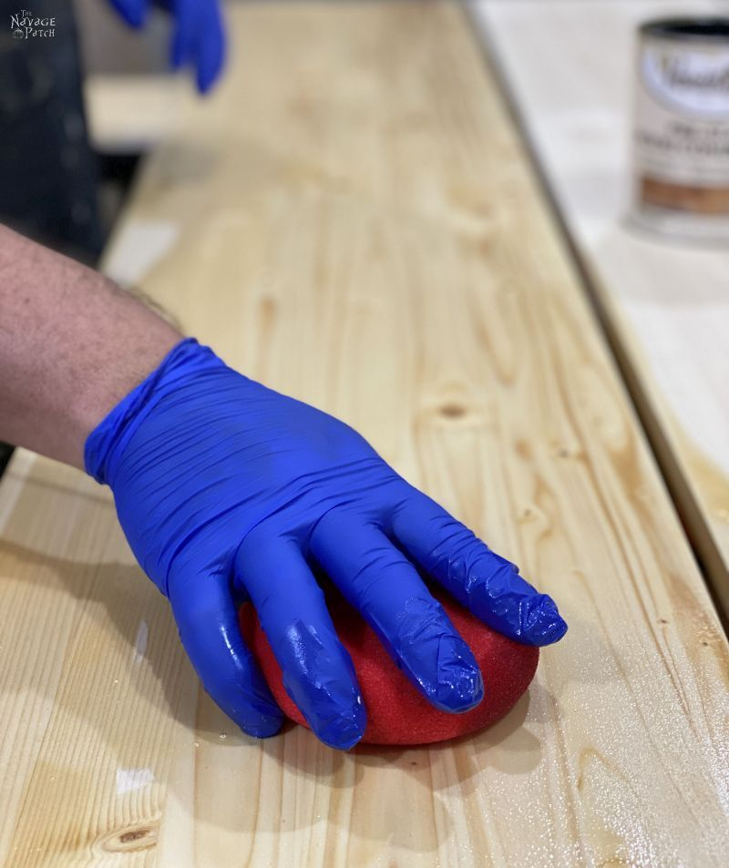 applying pre-stain to a board