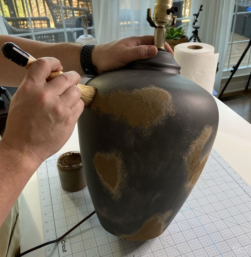 mud painting a lamp