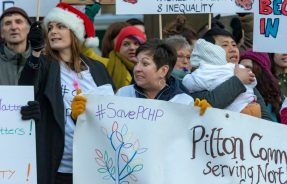Over one hundred people protested outisde the City Chambers on Friday