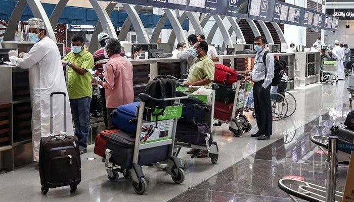 Passengers undergo routine checks to get their boarding passes at the Muscat International Airport. Photo: AFP