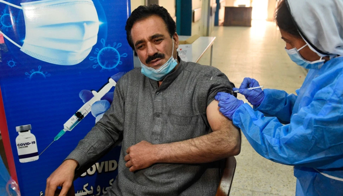 A doctor receives a dose of the Chinese-made Sinopharm COVID-19 vaccine at a vaccination center in Quetta, Pakistan, on February 3, 2021. — AFP/File