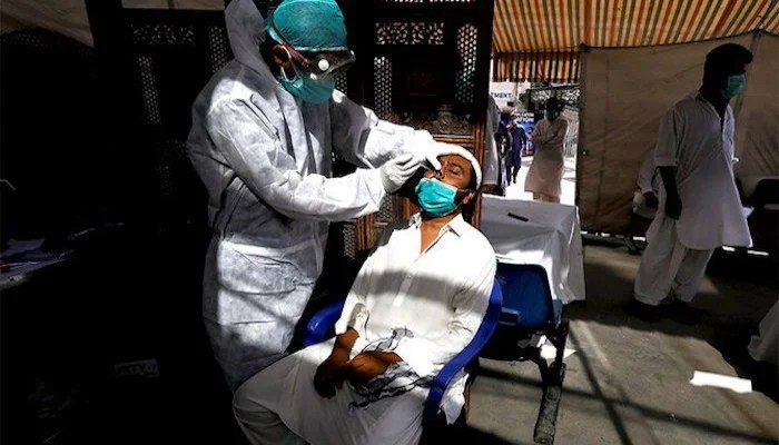A healthcare worker administering the coronavirus test on a patient. Photo: file