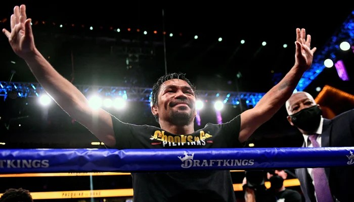 This file photo taken on August 21, 2021 shows Manny Pacquiao of the Philippines waving and bowing at the crowd after losing against Yordenis Ugas of Cuba following the WBA Welterweight Championship boxing match at T-Mobile Arena in Las Vegas. — AFP