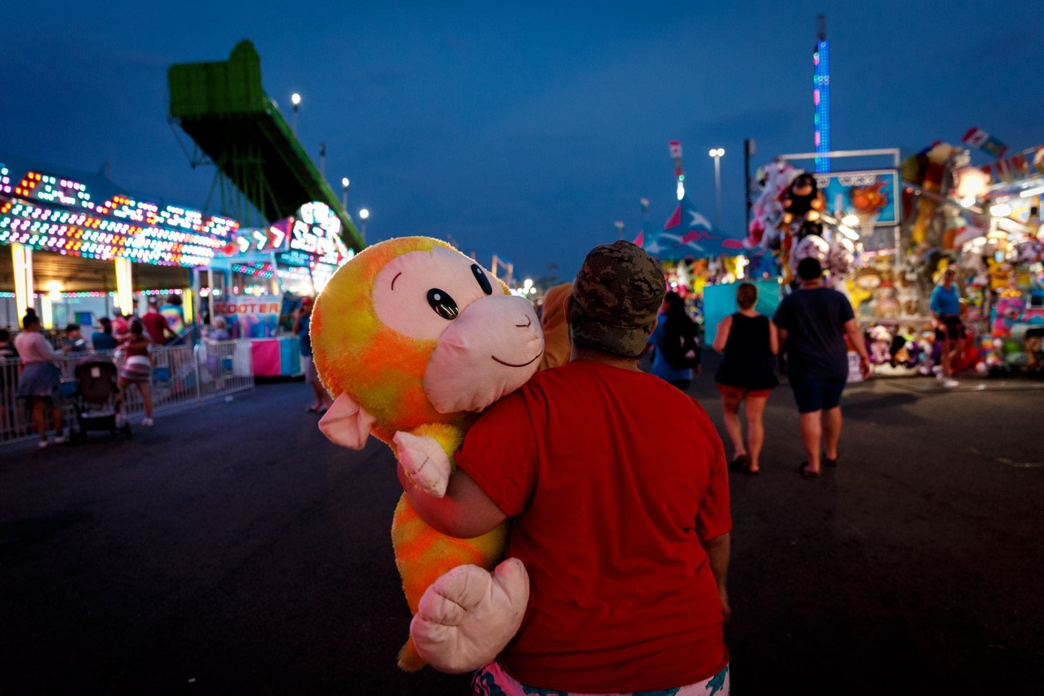 Scenes from the New York State Fair - A fairgoer takes home an oversized stuffed animal