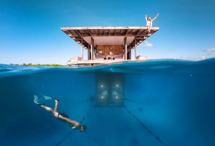The Manta Resort's three-story room features an outdoor roof, landing deck at sea level, and a submerged bedroom.