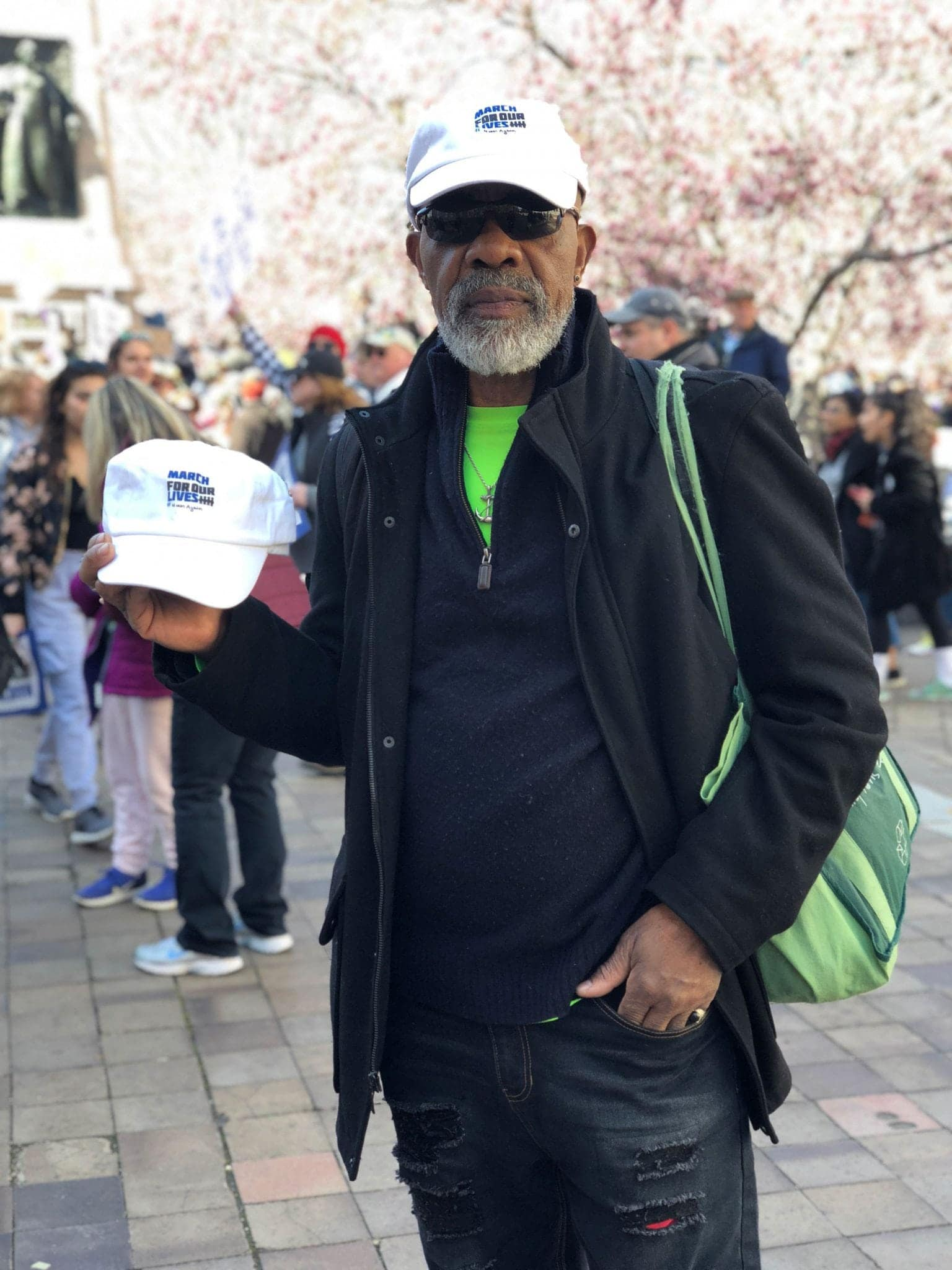 Vendor sells hat during march