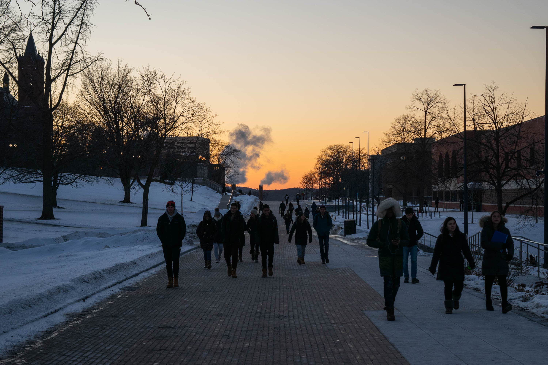Students walk Syracuse University's promenade Thursday as temperatures hover around 0 degrees.