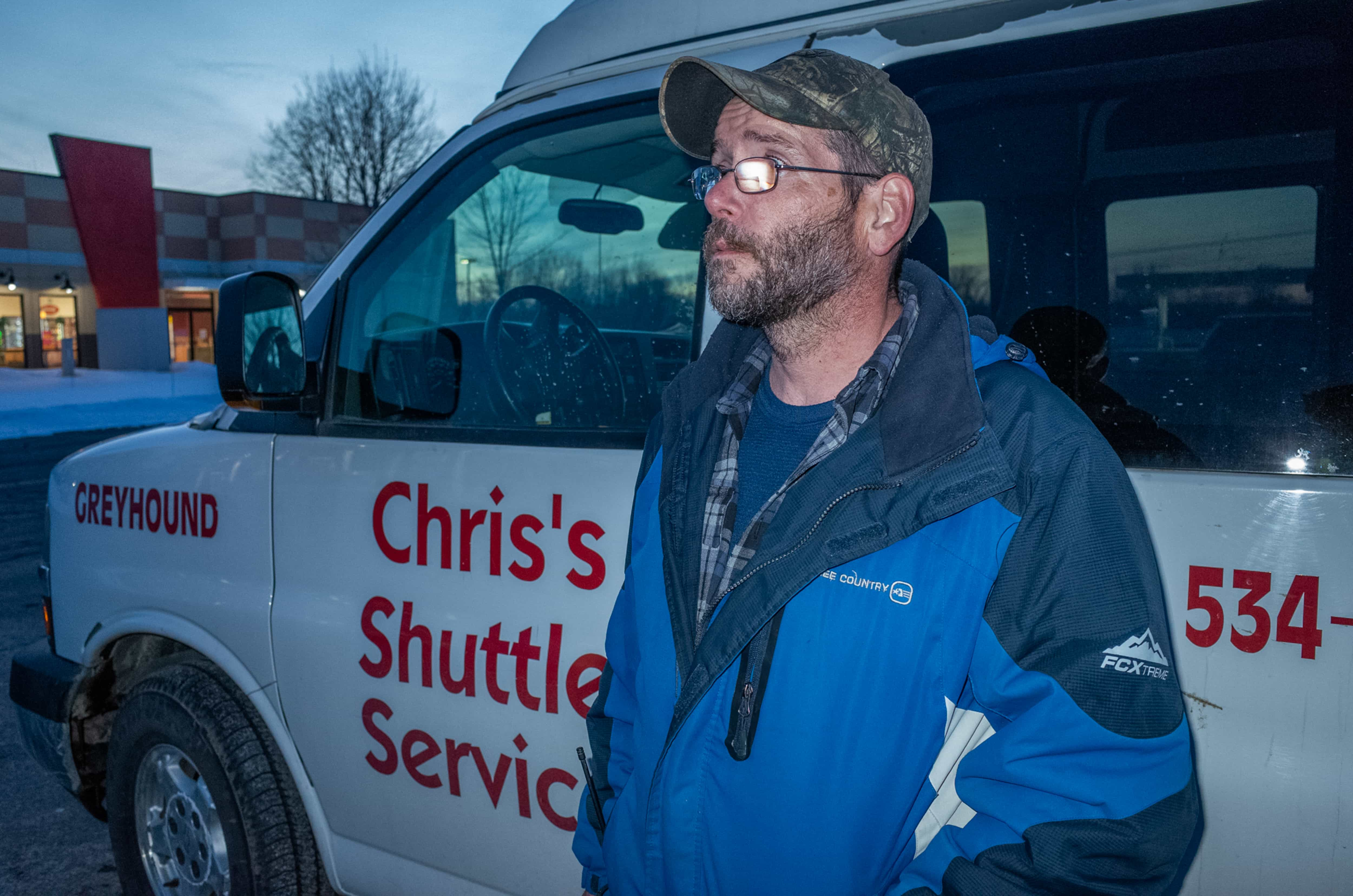 George Ero waits for a Greyhound bus to arrive in Plattsburgh, NY on March 1. Ero works for a taxi company and greets any asylum seekers as they hop off the bus, ferrying them the rest of the way to Roxham Road.
