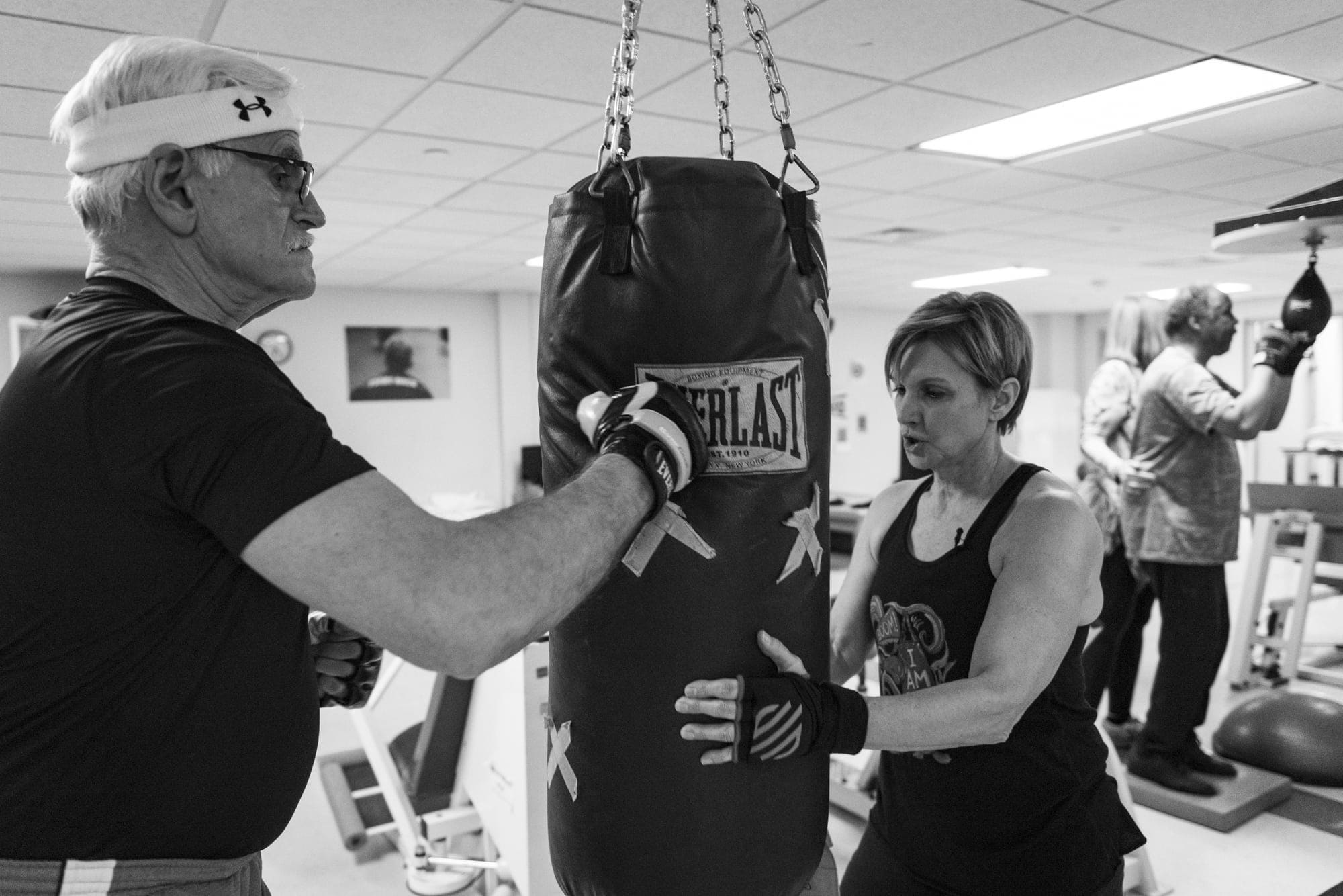 Karen coaches her Rock Steady Boxing peers.