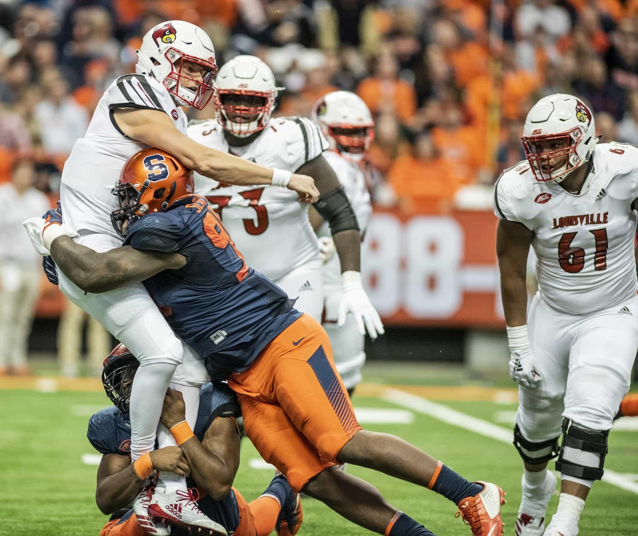 SU vs Louisville: Cardinals quarterback Sean McCormack gets hammered by SU Orange D-linemen Chris Slayton and McKinley Williams