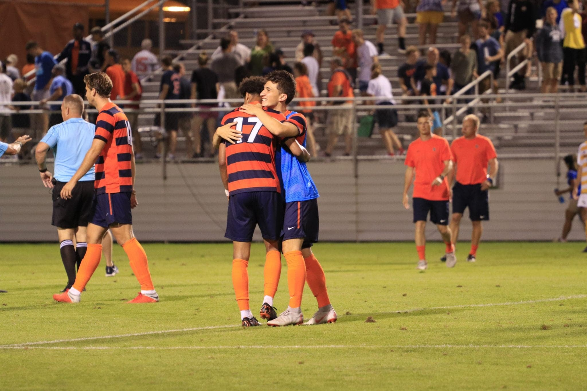 Syracuse sophomore Tajon Buchanan is embraced by a teammate after SU's men's soccer win over Hofstra on Sept. 2, 2018