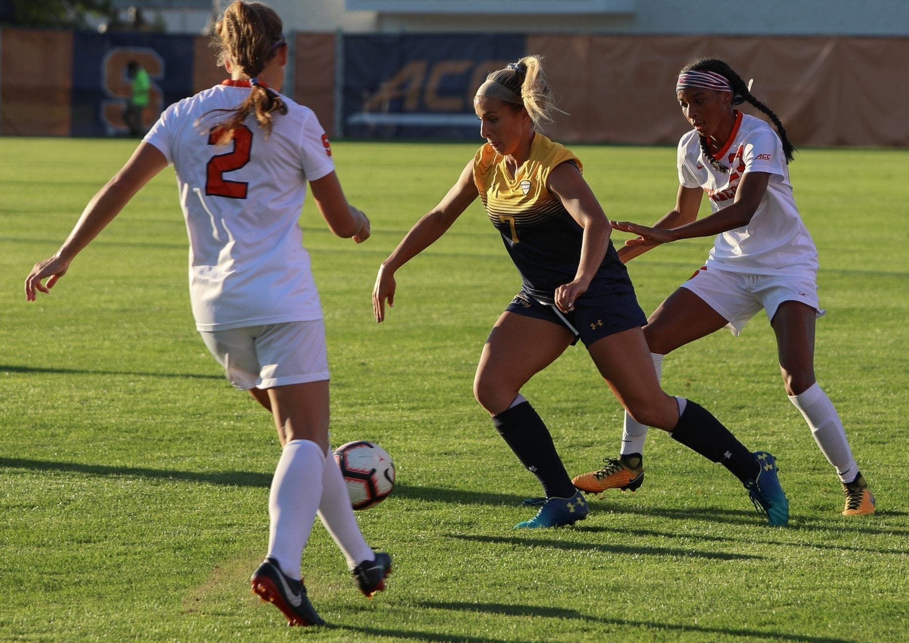 Syracuse soccer's Kate Donovan (left) and Clarke Brown (right) close in on Kent State's Yasmine Hall