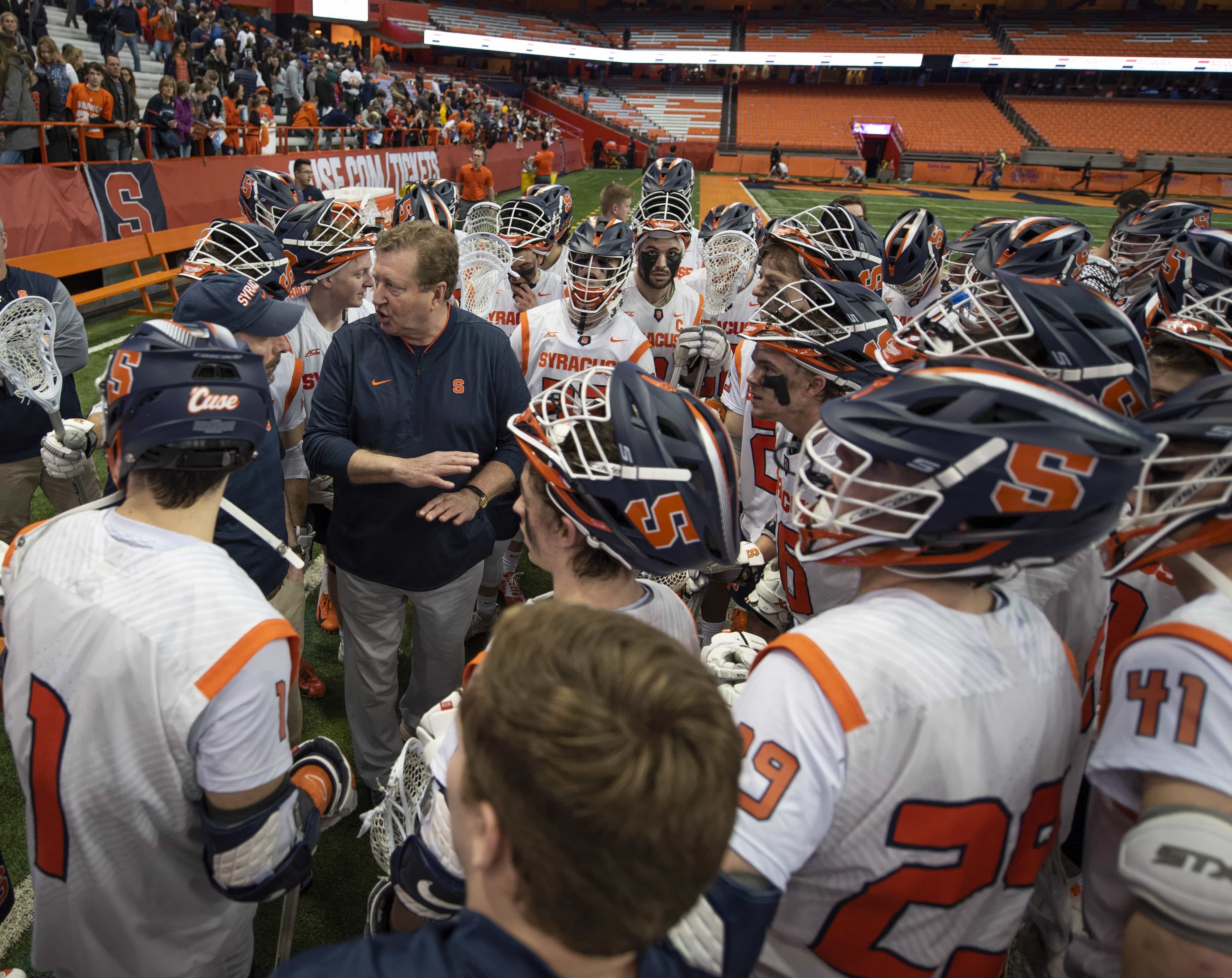 SU head coach John Desko speaks with the team after a 10-8 win over Army.