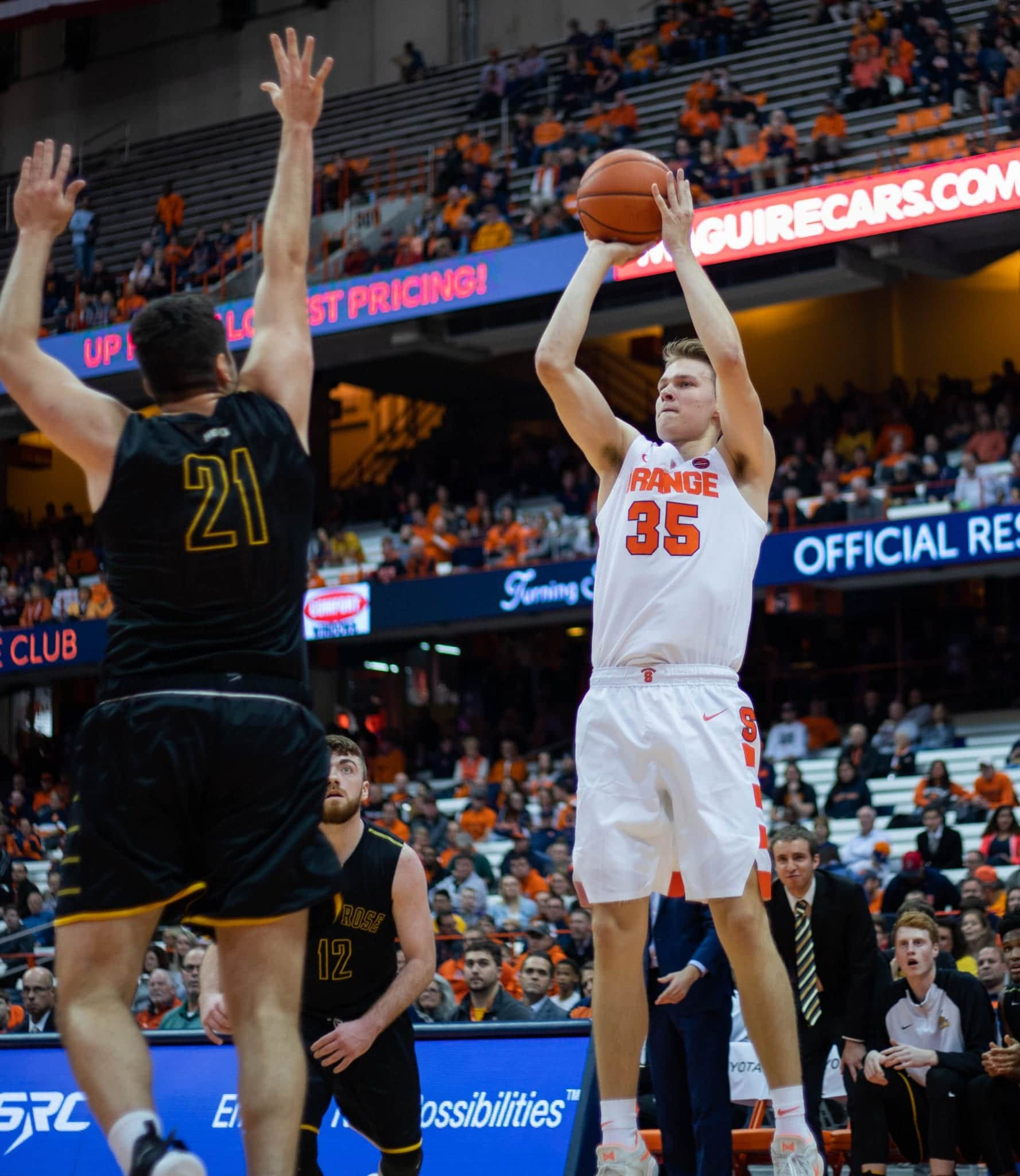 Buddy Boeheim shoots over a Saint Rose defender. Boeheim finished with 19 points in his Syracuse debut.