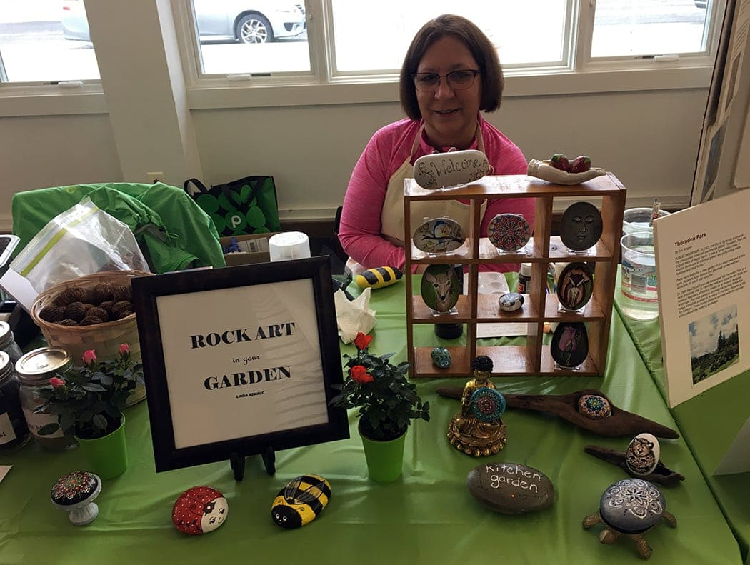 Linda Szmalc taught attendees about how to make rock art at the Syracuse Rose Society Fair on April 28, 2018
